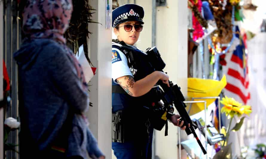 An armed police officer standing guard outside the Al Noor mosque in Christchurch