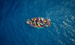 An aerial photo shows a boat carrying migrants stranded in the Strait of Gibraltar in September 2018.