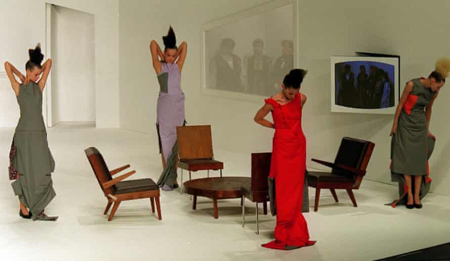 Models wear creations from designer Hussein Chalayan's Autumn/Winter 2000 collection, where a table was transformed into a skirt.