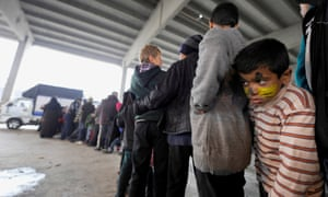A Syrian boy queues for food at a shelter in the government-controlled Jibreen area of Aleppo.