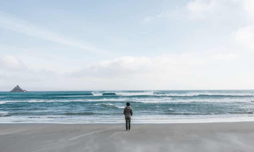Lonely person standing by the sea