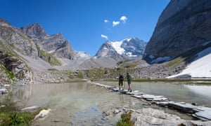 Walkers explore Vanoise national park near the resorts of Courchevel and Val-d'Isère, France.