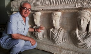 A 2002 picture of Khaled al-Asaad in front of a rare sarcophagus from Palmyra depicting two priests dating from the first century.