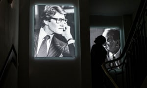 Portraits of Yves Saint Laurent (L) and his partner Pierre Bergé on display at the museum in Paris.