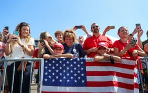 A closely packed crowd of Trump supporters, most without masks, listen to U.S. President Donald Trump speak to the crowd after arriving at Tampa International Airport, on a day when the state of Florida registered and announced 257 new COVID-19 fatalities, a record increase in coronavirus disease deaths for the fourth straight day in a row, in Tampa, Florida, U.S., July 31, 2020.