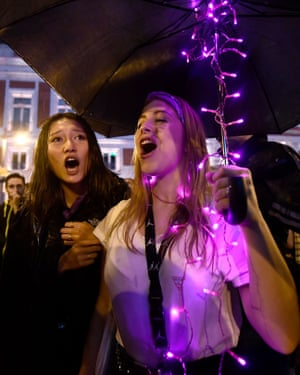 Women protest in the rain at the Puerta del Sol square in Madrid.
