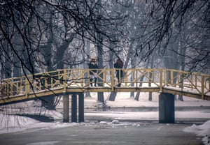 Girls take a picture on the bridge in the city park in Skopje, Macedonia