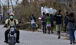 Women carry relief supplies Port-au-Prince, Haiti on 11 October 2016