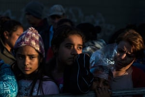 Central American migrants, traveling to the united States, line up to receive gifts from a NGO (Non-governmental organization) as as part of the Christmas celebrations outside a temporary shelter downtown Tijuana, Baja California state, Mexico on December 24, 2018.