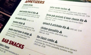A new menu from Applebee's restaurant featuring salt warnings is seen at one of its outlets in New York City.