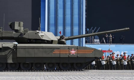A Russian serviceman holds a red flag on board the T-14 Armata tank after it stopped during a Victory Day parade rehearsal in Red Square, Moscow.