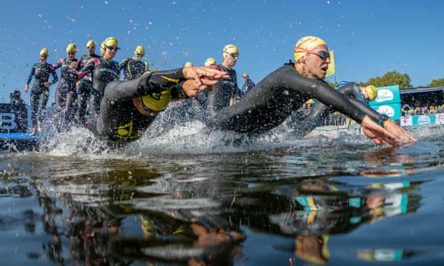 Group of swimmers at an organised event, on a sunny day, in the Serpentine, London, UK.