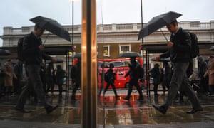 Commuters cross London Bridge, as economic activity slowed.