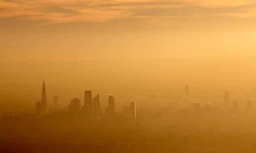 The city of London in fog and air pollution.