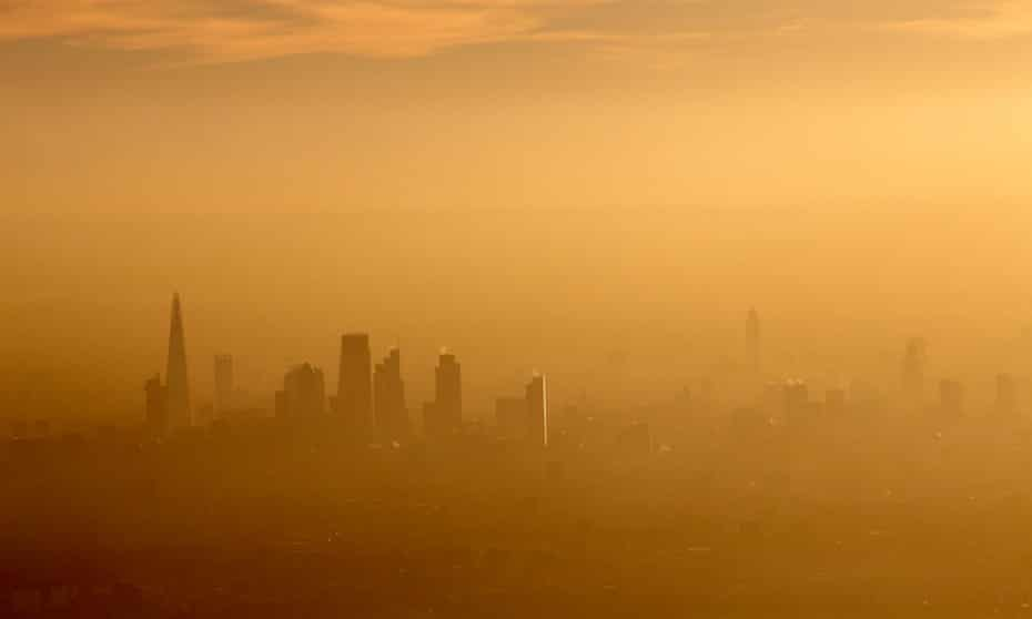 Aerial view south across the city of London in fog and or air pollution.