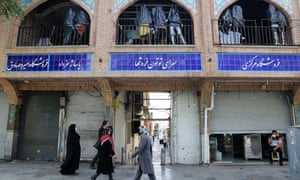People walking past closed shops at Grand Bazaar yesterday as Iran imposed a 10-day lockdown across most of the country.