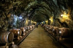 Barrels of red wine in a cave cellar in Danba county, Ganzi Tibetan Autonomous Prefecture.