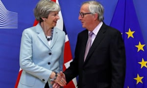 Theresa May and Jean-Claude Juncker in Brussels in December.