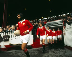 George Best leads out the Manchester United team against Birmingham City in October 1973