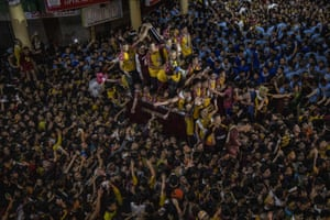 Catholic devotees take part in the Black Nazarene procession.