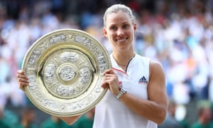 Angelique Kerber poses with the Venus Rosewater Dish after defeating Serena Williams 6-3, 6-3 in their Wimbledon singles final.