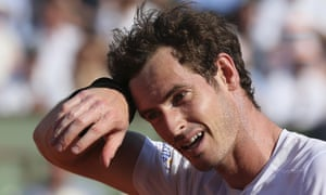 Murray wipes his sweat away as he stuggles in this match.