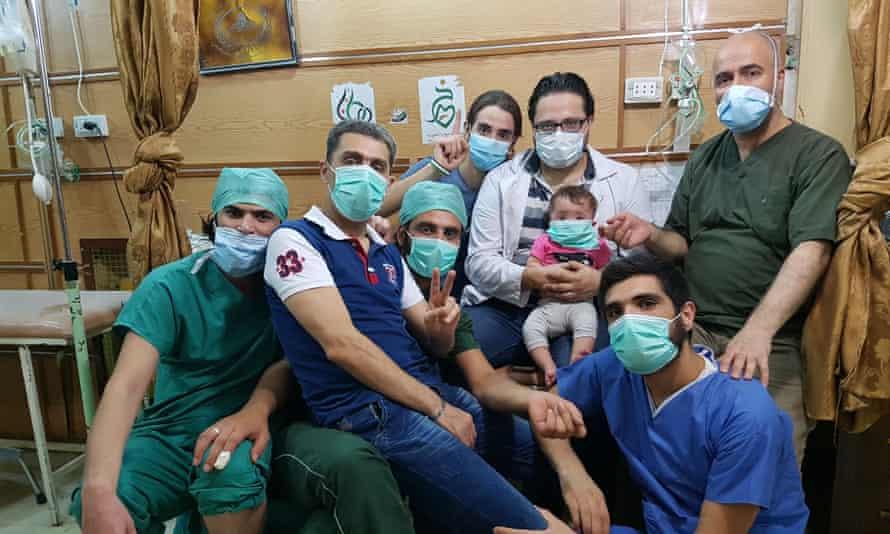 Hamza al-Kateab (centre) holding baby Sama in For Sama.