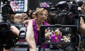 Elizabeth Warren speaks to members of the press during a demonstration against the supreme court nominee Brett Kavanaugh on Thursday.