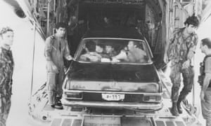 Soldiers return to Israel in a black Mercedes used in the raid on Entebbe, July 1976