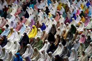Muslim women pray on the first day of the holy month of Ramadan at Istiqlal mosque