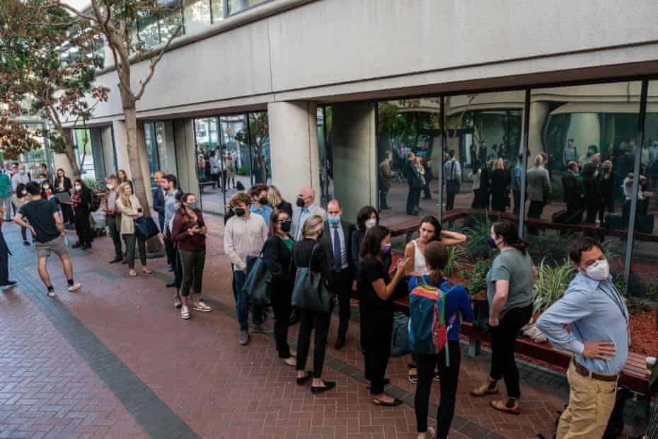 People line up for the fraud trial of Elizabeth Holmes outside the courthouse in San Jose on 8 September.