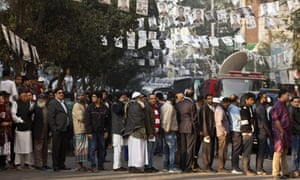 Bangladeshis line up to cast their votes in Dhaka