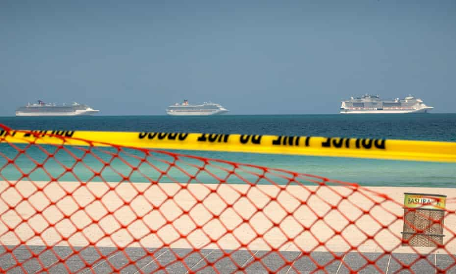 Cruise ships sit off shore near the Port of Miami in Florida.
