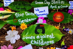 Slogans and pictures on plant leaves as part of a 'green day strike' in Ye in Mon state