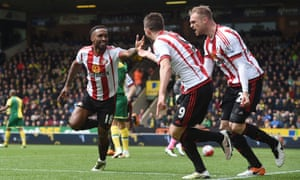 Jermain Defoe celebrates with Fabio Borini and Jan Kirchhoff after all contributed to the second goal.