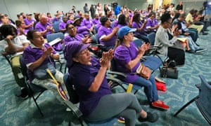 Airport workers attend a roundtable discussion on hazardous conditions at Miami international Airport in Miami, Florida, on 24 April.