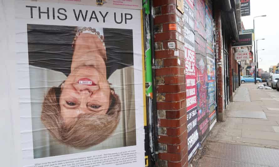 Theresa May upside down poster