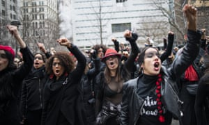 Women protest against rape in front of the courthouse where Harvey Weinstein attended a pretrial session on Friday in New York City.
