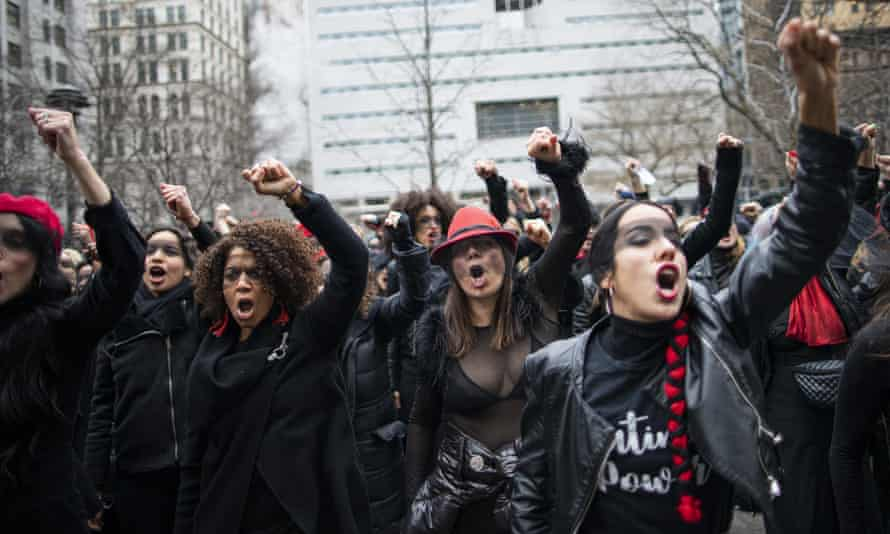 Women protesting outside Harvey Weinstein's trial in New York