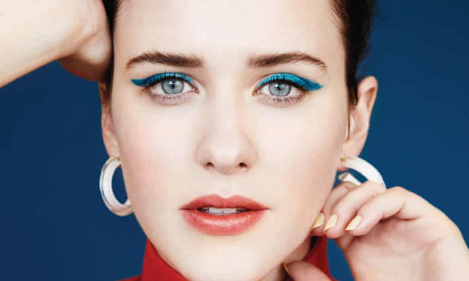 Close-up of Rachel Brosnanhan's face, a streak of bright blue eyeshadow and thick hoop earrings