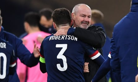 The Scotland manager, Steve Clarke, embraces his captain Andy Robertson after Scotland beat Israel in the Euro 2020 playoff semi-final.