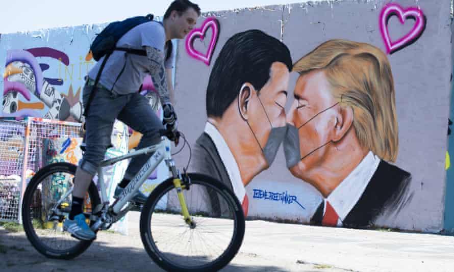 Graffiti in Berlin depicting the US president, Donald Trump, and China's president, Xi Jinping, wearing face masks amid the coronavirus pandemic