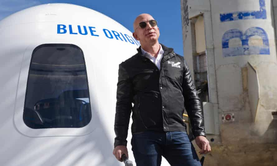 Amazon founder Jeff Bezos in 2017 with some of the space hardware belonging to his Blue Origin space project.