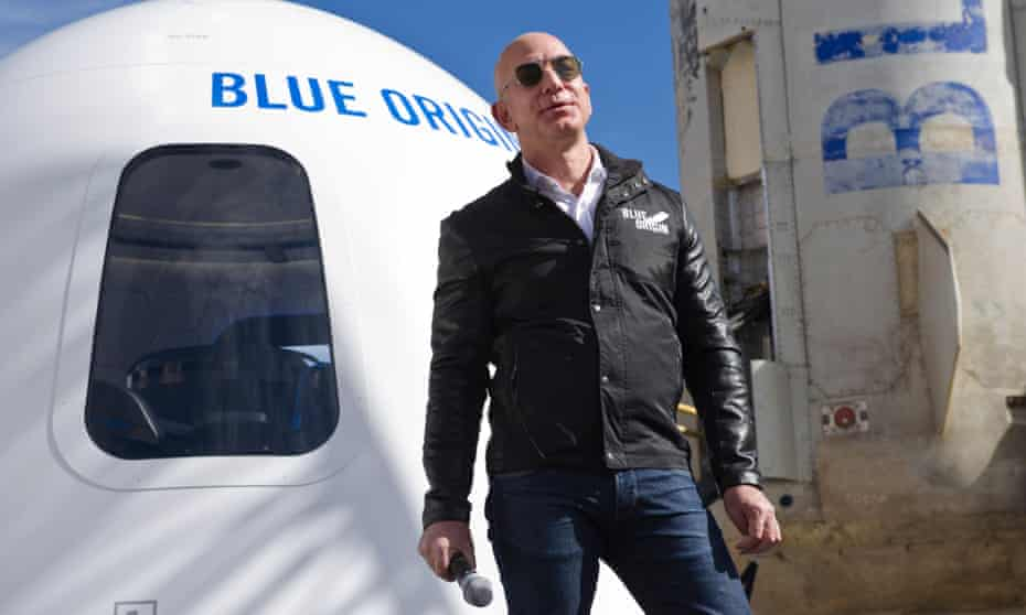 Jess Bezos in 2017, with his Blue Origin rocket. On Saturday, the winner of an auction for a seat to accompany Bezos and his brother Mark on his big space adventure will be announced.