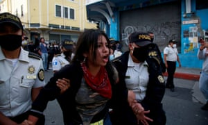 A demonstrator is arrested during clashes between the police and protesters in Guatemala City on Saturday.