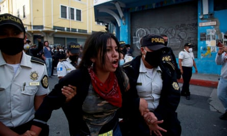 A protester is arrested during clashes between police and protesters in Guatemala City on Saturday.