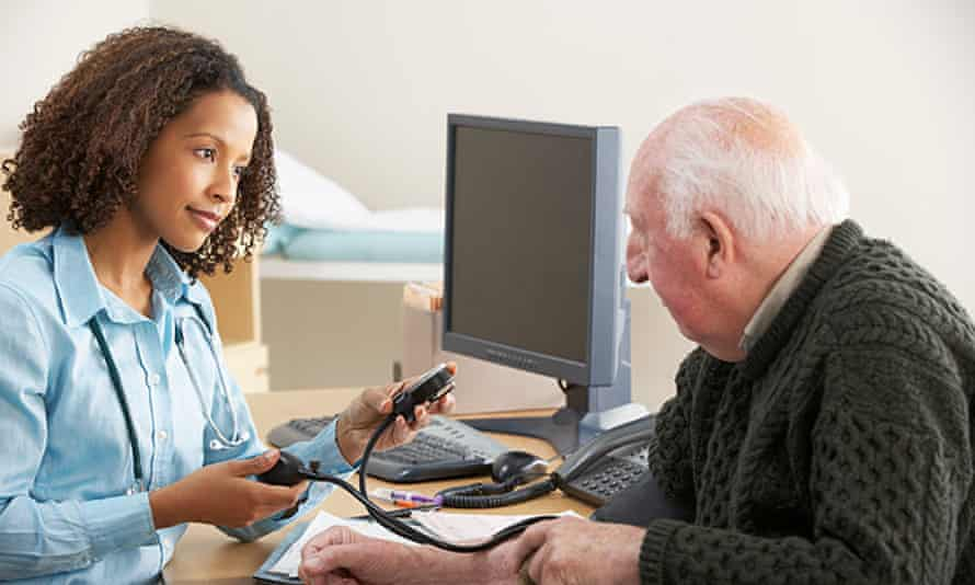 Young doctor taking senior man's blood pressure