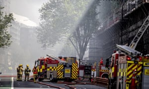 Fire engines attend to a fire in the central business district of Aukland New Zealand