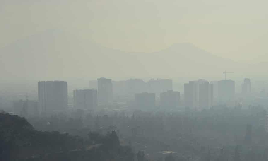 A layer of smog over Santiago caused by industry emissions and a growing number of cars.