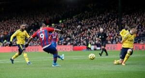 Crystal Palace's Jordan Ayew scores with a deflected shot.